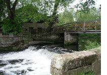 The saxon mill weir and foot bridge